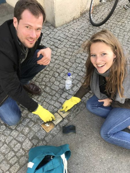 Co-Workers Cleaning Stones in Berlin
