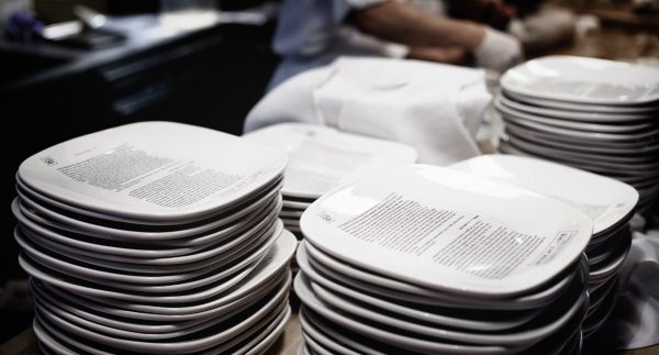 Plates in a Restaurant Kitchen with Bing Decode Text Written on Top