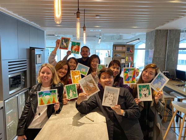 Hong Kong Office Holding Up Watercolor Paintings